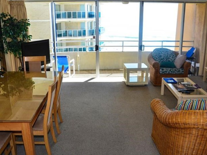 Zenith Oceanfront Apartments - Living Area and Balcony
